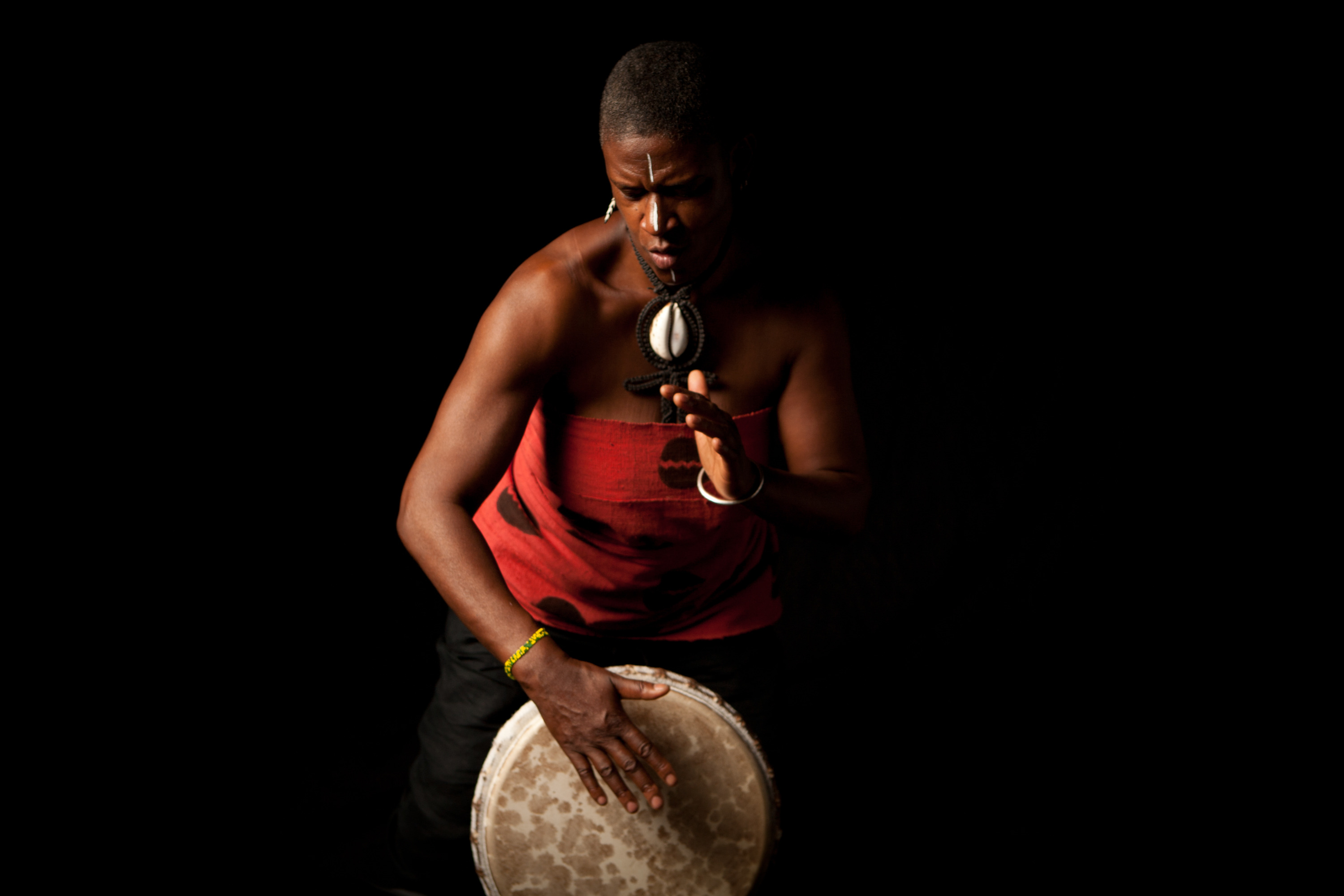 Mar Stevens, Oakland, CA, on west African drums (djembe and djuns)